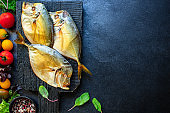 fish sea smoked vomer organic ingredient cook a snack meal on the table tasty serving size portion top view copy space for text food background rustic diet pescetarian