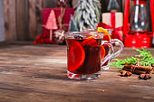 mulled drink red wine fruit tea hot grog glass winter serving size spices beverage New Year and Christmas top view copy space for text food background rustic