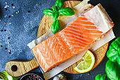 salmon fish red variety fresh seafood Menu concept serving size. food background top view copy space for text keto or paleo pescatarian diet organic healthy eating