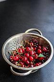 cherries red fresh juicy fruit berries sweet and healthy treat Menu serving size. food background top view copy space organic healthy eating