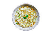 soup vegetables and pasta alphabet, peas, corn Menu concept healthy eating. food background top view copy space for text table setting keto or paleo diet