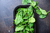 spinach salad green juicy leaves organic salad serving size natural top view copy space  for text diet raw food background rustic