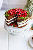 christmas cake chocolate with white butter cream fruit pudding red berries currant serving size New Year's natural product portion top view place for text copy space