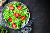 salad vegetables, lettuce and tomato Menu concept. food background top view copy space for text healthy eating keto or paleo diet organic