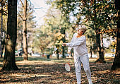One mid adult woman plays badminton