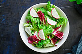 Healthy salad, leaves mix salad (mix micro greens, vegetable juicy snack). food background Image, copy space for text keto or paleo diet