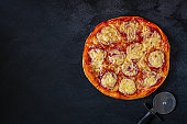 pizza salami sausages (tomato sauce, cheese, meat). food background. top view. copy space