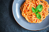 spaghetti pasta tomato sauce serving size second course. food background top view copy space for text healthy eating