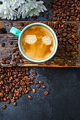 coffee drink and coffee grain (beverage, delicious hot drink). top view. copy space