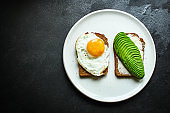avocado sandwich, healthy food (bread toast snack) menu concept. food background. top view. copy space