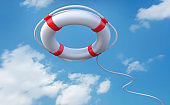 Red and white life saver with blue sky background