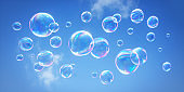 Soap bubbles flying in the blue sky