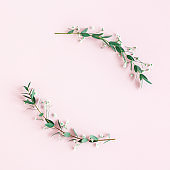 Flowers composition. Wreath made of gypsophila flowers, eucalyptus leaves on pink background. Spring concept. Flat lay, top view, copy space, square