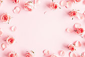 Flowers composition. Rose flowers on pink background. Valentines day, mothers day, womens day concept. Flat lay, top view, copy space