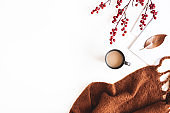 Autumn composition. Cup of coffee, plaid on white background. Autumn, fall concept. Flat lay, top view