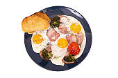 Traditional breakfast with bacon, fried eggs, tomato, broccoli and toast, isolated on white background