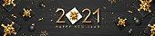 2021 Happy new year, black gift box golden ribbon, black ball, snowflake, concept design on black wood background
