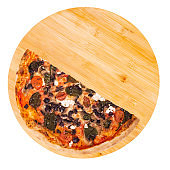 A half of tasty pizza with cherry tomatoes, spinach, mozzarella, feta, kalamata olive and mushrooms on a wooden platter isolated on white background, top view