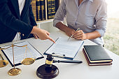 Woman judge is currently advising clients on their requests for legal proceedings and legal advice.