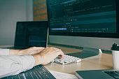 Close up of hands contemporary website developer man typing and writing code for program website.