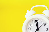 Close-Up Of Alarm Clock Over Yellow Background. Time concept.