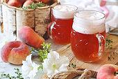 Two mug of light fruit craft beer