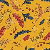 seamless vector pattern of colorful autumn leaves and rowan berries on a yellow background in doodle style