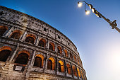 The majestic Coliseum of Rome in a  summer warm night: vacations in Italy
