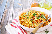 Spaghetti in spicy red sauce, capers and olives