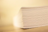 Close up of stack of papers on white background. Office: Pile of Paper.