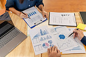 Financial auditor meeting analyzing a valuation of investment data.