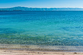 The water surface of Lake Sevan with a beautiful view of the mountains, the famous natural landmark of Armenia
