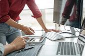 Development programmer writing a code on database, Teamwork cooperation.