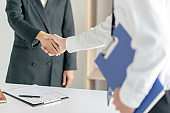 Recruitment concept, Candidate hand shaking with human resource.