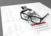 eye healthy concept, eyeglasses and eye chart puzzle stock photo