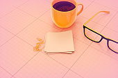 Office desk with coffee and glasses stock photo