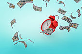 finance and economy concept Falling Money on blue background stock photo