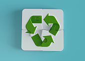 Recycling Symbol puzzle pieces, green energy concept stock photo