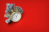 Cash bills as symbol of financial stability, moneys and chronometer isolated on red background stock photo