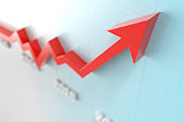 Red Arrow Moving Up Over Graph Background stock photo