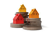 House and Money stacks Real Estate and Savings Concept stock photo