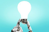 Inspiration - Light Bulb Robot Hand Idea on Blue Background stock photo