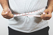 Obese men, they try to lose weight, such as diet and exercise every day.