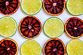 Red orange and lime fruits isolated on white background.