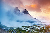 Majestic foggy view of the National Park Tre Cime di Lavaredo with rifugio Locatelli. Dolomites, South Tyrol.