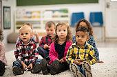 Multi-Ethnic Preschool Kids During Story-time stock photo