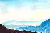Beautiful mountain landscape of morning sky and rolling mountains far and near. Watercolor illustration with space for text on the theme of the beauty of winter nature.
