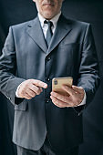 Businessman surfing the net on smart phone