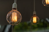 Vintage antique hanging light bulbs. Holidays and business good idea concept.