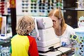 Kids eye sight test. Little boy at ophthalmologist